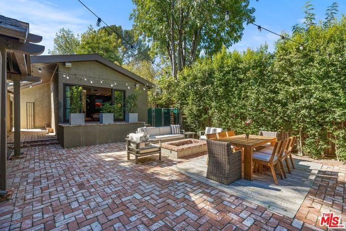 Patio with dining area and fire pit
