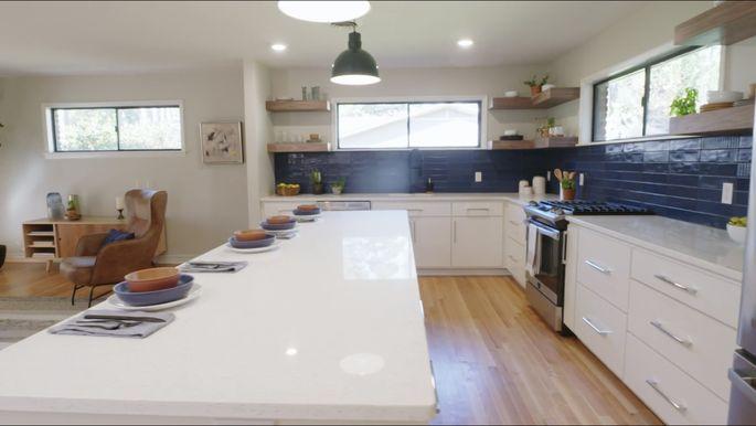 This dark, textured backsplash gives this kitchen a masculine look.