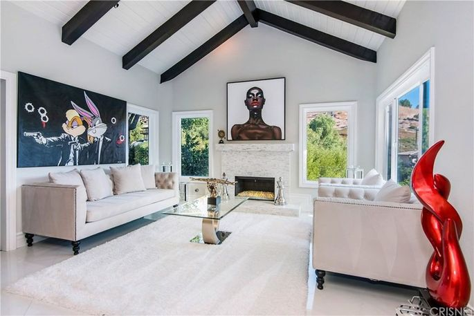Living room with fireplace and vaulted and beamed ceiling