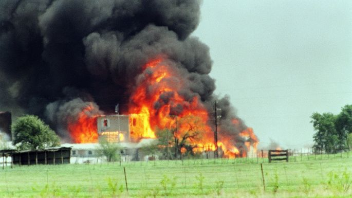 The Branch Davidian cult compound observation tower in Waco, TX, engulfed in flames