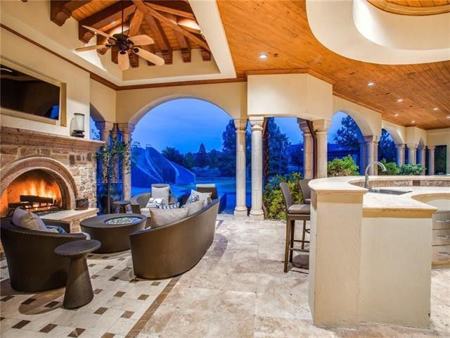 Covered outdoor space with fireplace