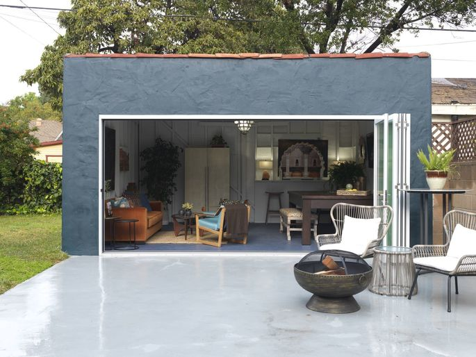 The old garage door was replaced with a new, folding glass door to add lots of natural light.