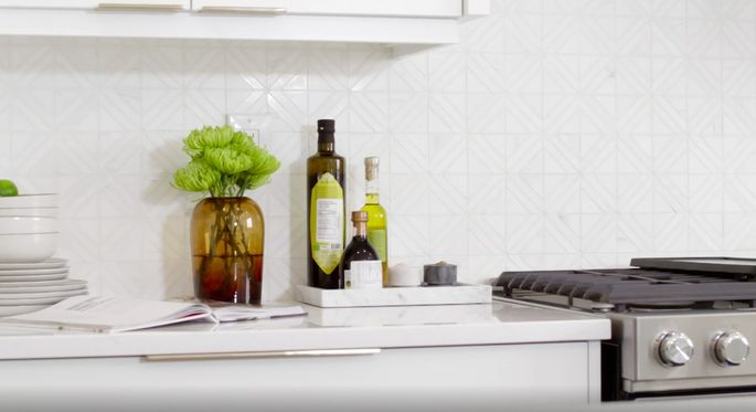 This white kitchen needed a backsplash with a little something extra. This tile is the perfect choice!