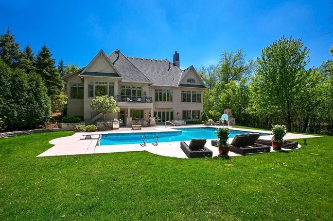 Pool with patio and grassy yard