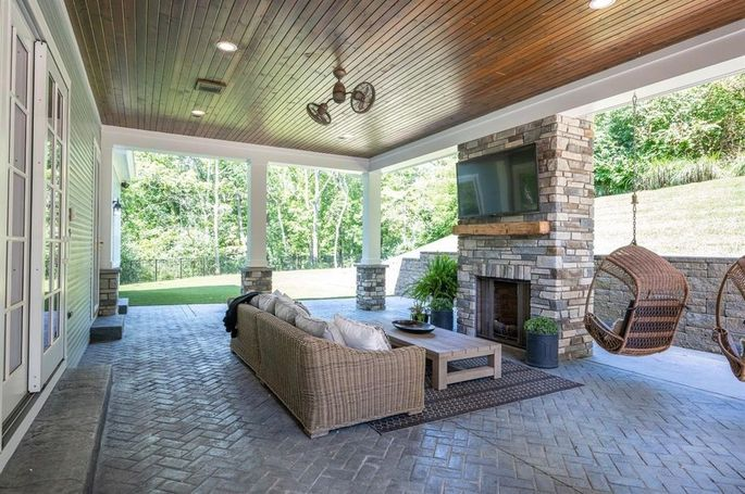 Covered deck with outdoor fireplace