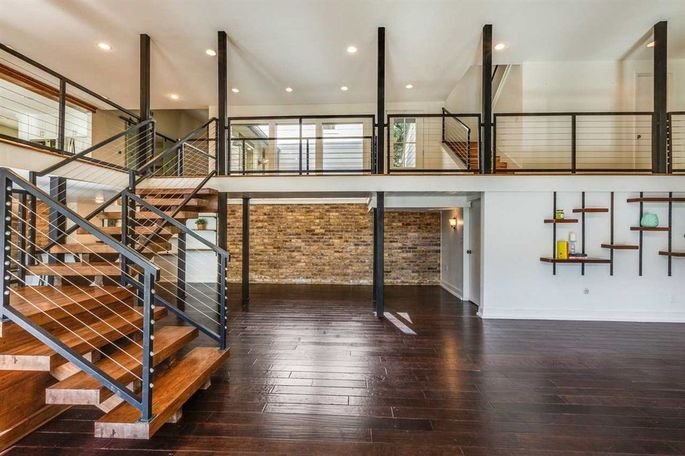 After: New stairwell with iron railings and steel cables