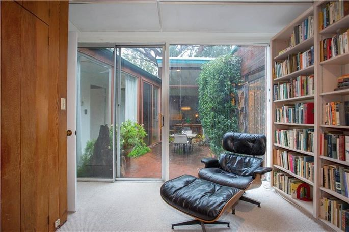 Den and adjacent atrium