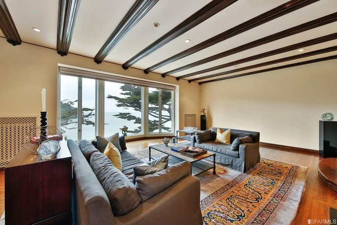 Living room with beamed ceiling and huge windows