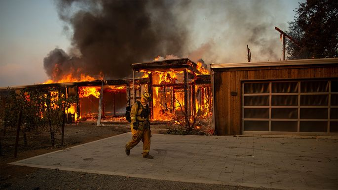 A house burns during the Kincade fire in Healdsburg, CA, in October 2019.