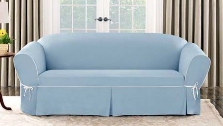 Cover up dated or worn furniture with a slipcover.