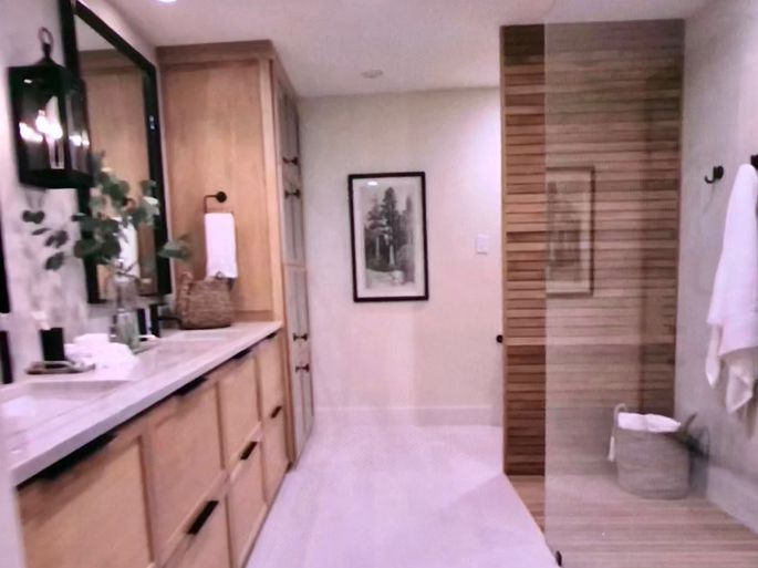 Teak Adds Warmth To A Sleek White Bathroom