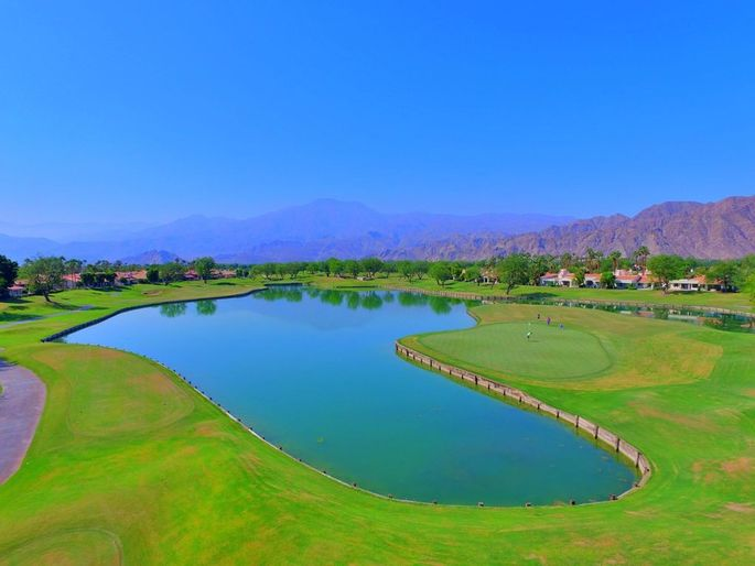 Golf course, water and mountain views.