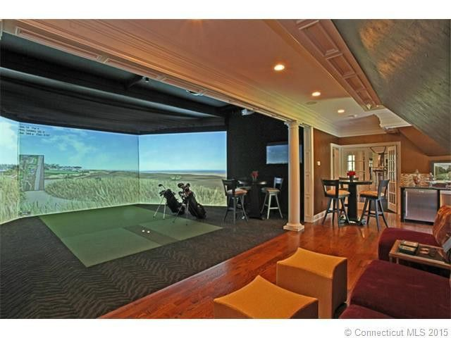 Golfers gone wild 6 homes with indoor golf simulators for Golf simulator room dimensions