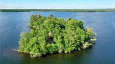 Up for a Challenge? Consider This Log Home on a Private Island in Wisconsin
