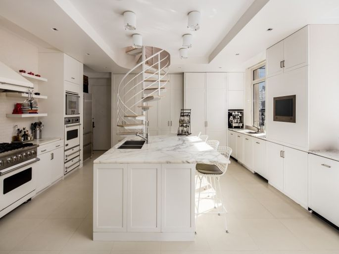 White kitchen and spiral staircase