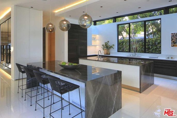 Chef's kitchen with two marble counters