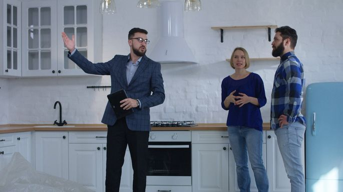 Real estate agent showing property to a couple