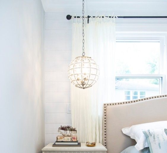 Hanging globe lights give the illusion of more space.