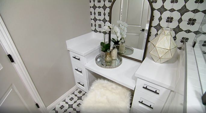 This makeup station adds some extra elegance to this master bathroom.