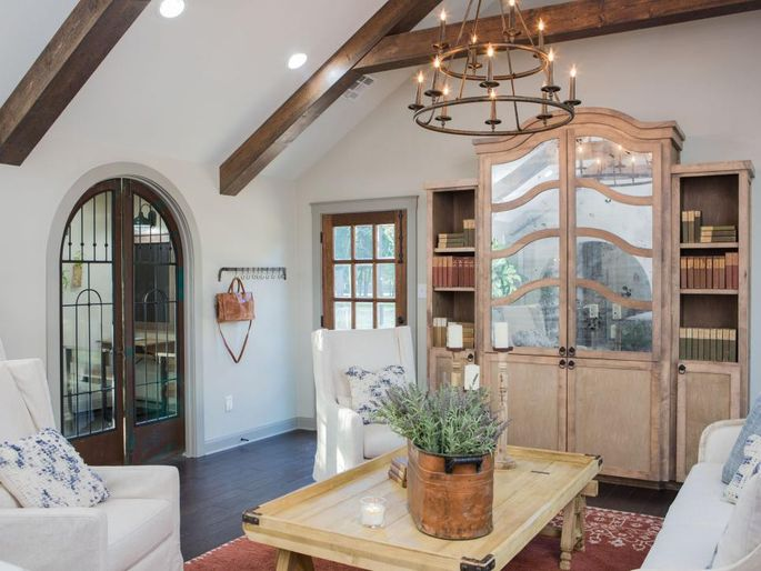 After: The newgarage conversion, as designed by Chip and Jo, has a vaulted ceiling and french doors.
