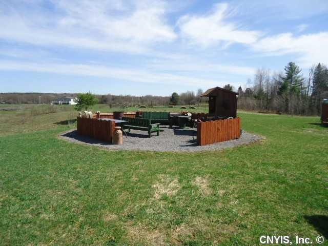 The outdoor kitchen and fire pit at a tiny house inupstateNew York