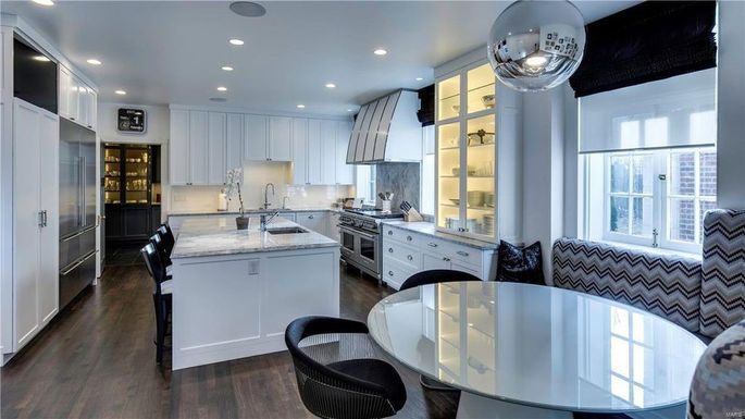 Renovated chef's kitchen with dining nook