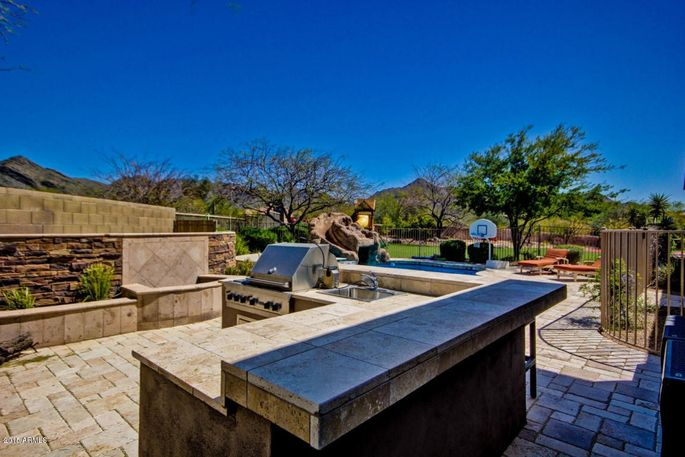 Outdoor kitchen and heated pool with slide