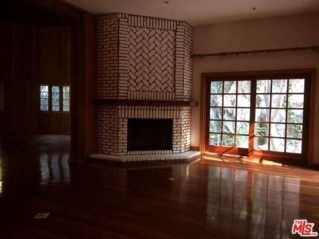 There are several fireplaces, and French doors leading out to decks in the former Tom Petty home