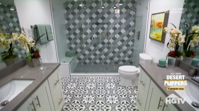 A bathroom with a whole lot of tile going on