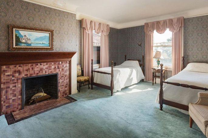 Bedroom with original fireplace