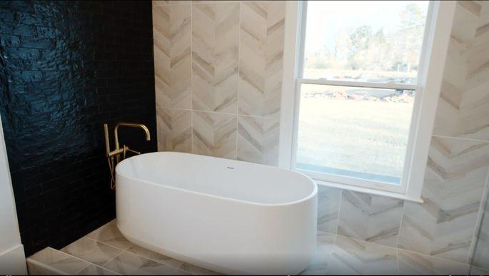 David Bromstad and Tiffany Brooks use light and dark tile.