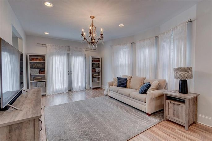 Family room with brass chandelier