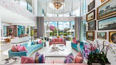 Luxe Mansion Built Around a Tropical Tree Is a Colorful Delight