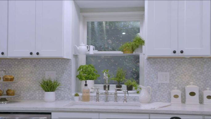 This window shelf provides the perfect spot for some beautiful greenery.